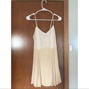 Cream dress with lace.